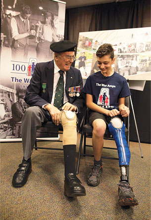 Second World War amputee veteran and War Amps member Charlie Jefferson with Champ Dante at the Canada Post commemorative envelope unveiling in Ottawa