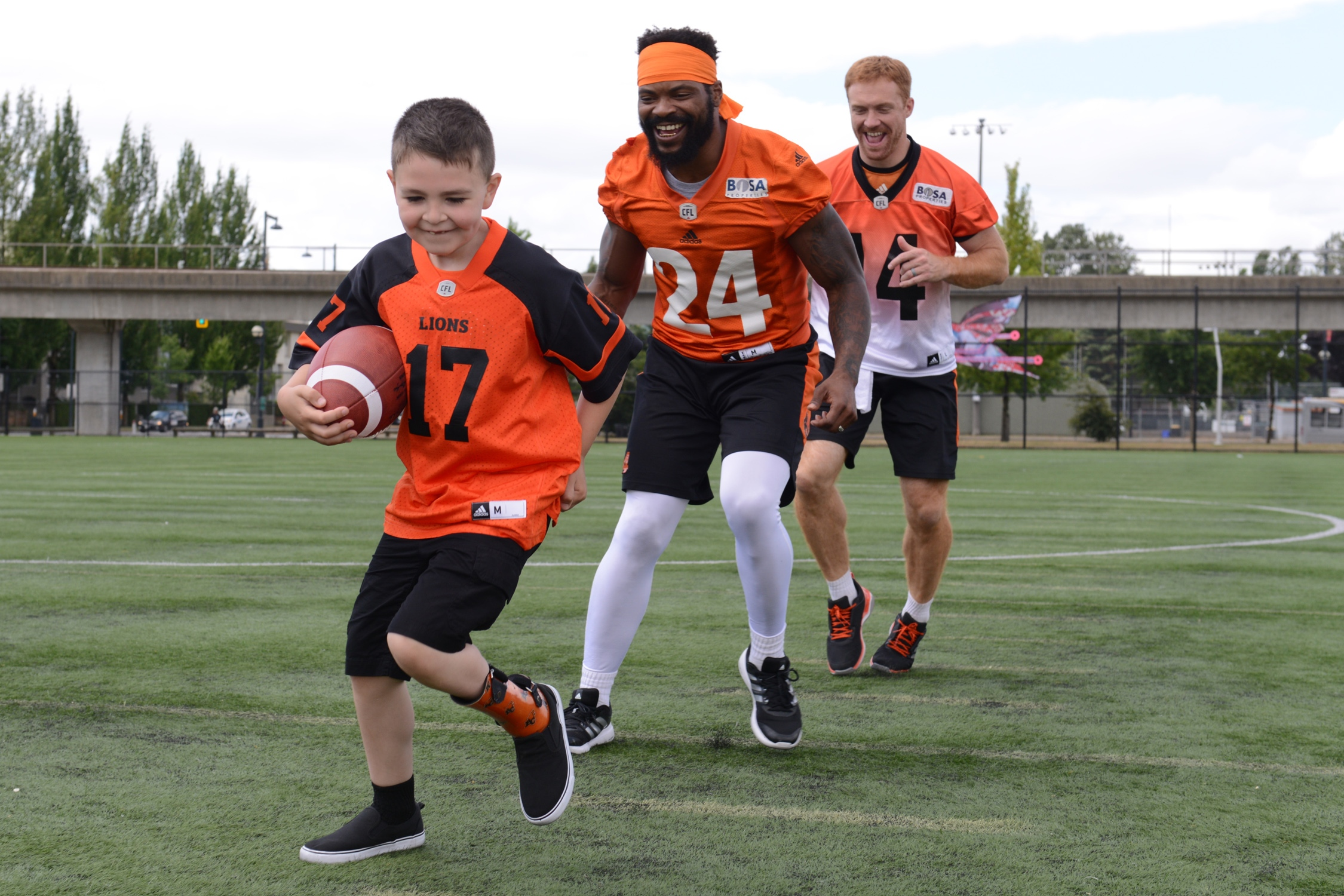 Darevin having fun on the shoot with players Travis Lulay (#14) and Jeremiah Johnson (#24).