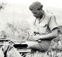 Cameraman Sgt. Norman Quick writes photo captions. Location: Cassino, Italy. (Private Collection)
